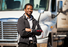 man standing in front of white commercial motor vehicle